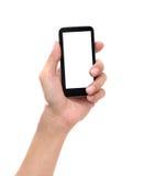 Hand die mobiele slimme telefoon met het lege scherm op witte backg houden Royalty-vrije Stock Afbeelding