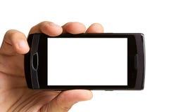 Hand die mobiele telefoon houdt, knippend inbegrepen weg Stock Foto's