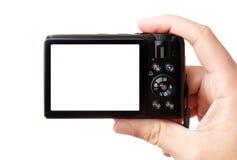 Hand, die moderne Digitalkamera anhält Stockfotografie