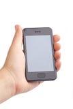 Hand die moderne slimme telefoon houdt Stock Foto