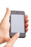 Hand die moderne slimme telefoon houdt Stock Afbeelding