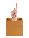 Hand, die oben aus dem Kasten heraus zeigt Lizenzfreie Stockfotos