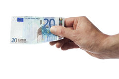 Hand, die Rechnung des Euros zwanzig hält Stockbild