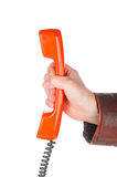 Hand die retro telefoonbuis houden royalty-vrije stock afbeelding