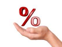 Hand die rood percententeken houden Het concept van de verkoop - hand met vergrootglas Stock Foto's