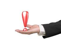 Hand die rood uitroepteken houden Stock Afbeelding