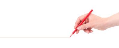 Hand, die rote Zeile mit Bleistift zeichnet   Lizenzfreie Stockfotos