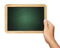 Hand, die Tafel auf Weiß hält Stockbild