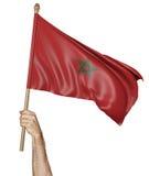 Hand die trots de nationale vlag van Marokko golven Royalty-vrije Stock Afbeeldingen