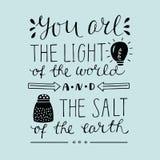 Hand die u van letters voorzien het licht van de wereld en het zout van de aarde royalty-vrije illustratie
