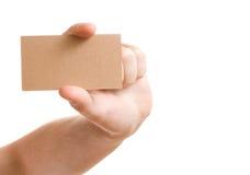 Hand, die unbelegte Visitenkarte zeigt Stockfotos