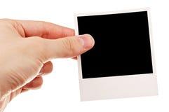 Hand, die unbelegtes Foto anhält Stockfotos