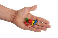 Hand, die vier Pfand hält stockfoto
