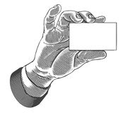 Hand, die weiße unbelegte Karte anhält Lizenzfreies Stockbild