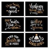 Hand, die Weihnachtskartensammlung mit frohen Zitaten beschriftet lizenzfreie abbildung