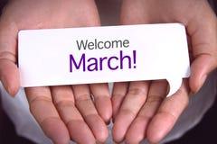 Hand die welkom maart tonen royalty-vrije stock afbeelding