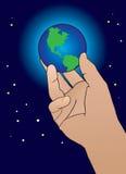 Hand, die Welt hält Stockbilder