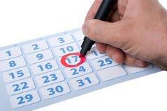 Hand, die wichtiges Datum schreibt Lizenzfreies Stockbild