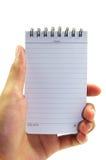 Hand die wit notitieboekje houdt Royalty-vrije Stock Afbeelding