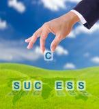 Hand, die Zeichen c zum Erfolgswort setzt Lizenzfreies Stockfoto