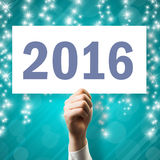 Hand, die Zeichen mit Text 2016 hält Lizenzfreies Stockfoto