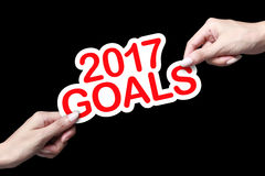 Hand, die Ziele des neuen Jahres hält Stockfotografie