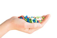 Hand with different pills Royalty Free Stock Photo