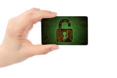Hand with digital card and open lock Stock Images