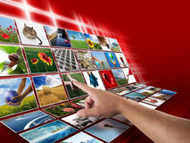 Hand on digital photo display Royalty Free Stock Image