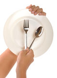 Hand with dinner plate. Hand holding dinner plate arrangement on isolated background Royalty Free Stock Images