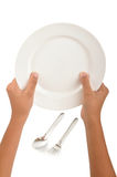 Hand with dinner plate. Hand holding dinner plate arrangement on isolated background Royalty Free Stock Photos