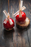 Hand dipped caramel apple covered with multi color sprinkles Royalty Free Stock Photography
