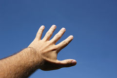 Hand directed to the blue sky. Daylight Stock Image