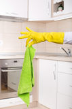 Hand with dirty mop in the kitchen Stock Photo