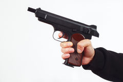 Hand with discharged semi-automatic gun on white background Royalty Free Stock Photos