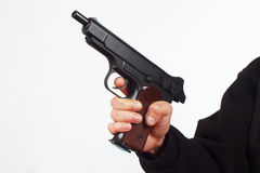 Hand with discharged semi-automatic pistol on white background Stock Image