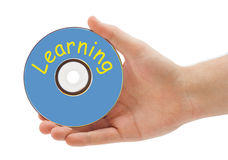 Hand with disk Learning Royalty Free Stock Images