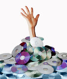 Hand and disks. A hand in a pile of disks royalty free stock photography