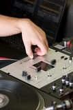 Hand of a dj adjusting the crossfader Royalty Free Stock Photography