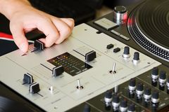 Hand of a dj adjusting the crossfader Stock Image