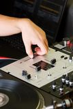 Hand of a dj adjusting the crossfader Royalty Free Stock Photo
