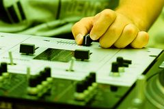 Hand of a dj adjusting the crossfader Stock Photos