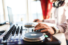 Hand of DJ on the decks Royalty Free Stock Image