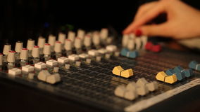 Hand DJ on a mixer, operating the leader stock footage