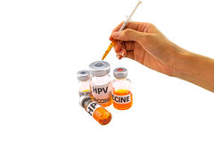 Hand of the doctor filling a vaccine syringe and bottle vaccine of Human papillomavirus (HPV) vaccine Stock Photos