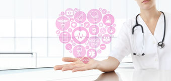 Hand doctor with medical heart icons. Hand doctor with medical heart pink icons Stock Photo