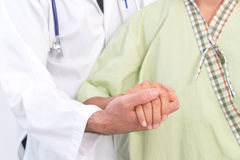 Hand of doctor reassuring her female patient stock photography