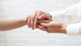 Hand of doctor reassuring her female patient. Stock Image