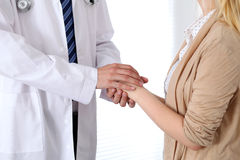 Hand of doctor  reassuring her female patient. Medical ethics and trust concept Royalty Free Stock Photo