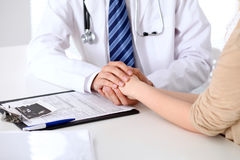 Hand of doctor  reassuring her female patient. Medical ethics and trust concept Royalty Free Stock Photography